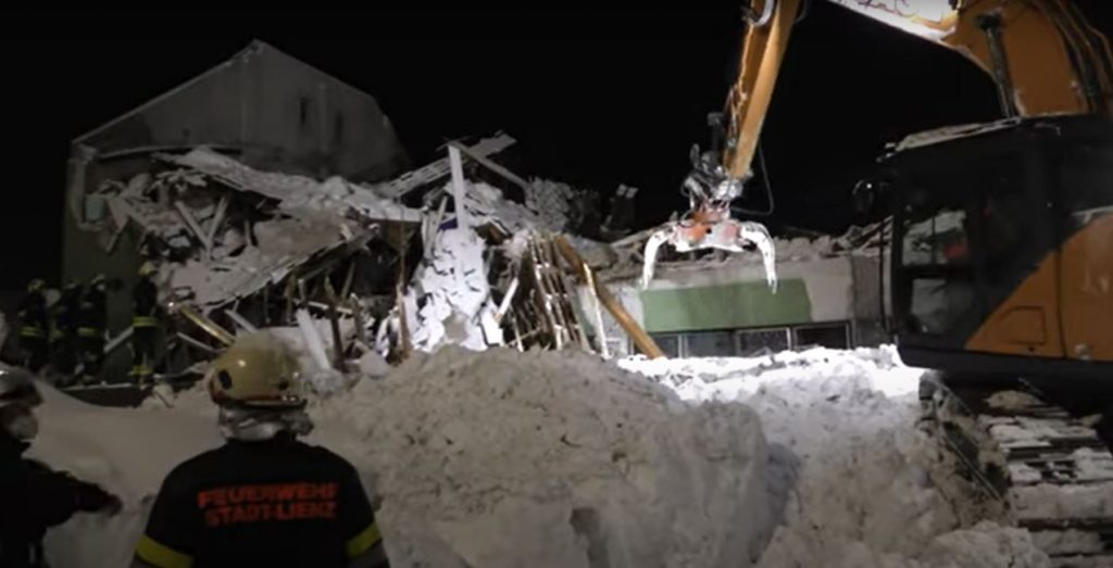 A warehouse collapsed under the weight of snow and a motorist was buried in an avalanche while driving in Austria