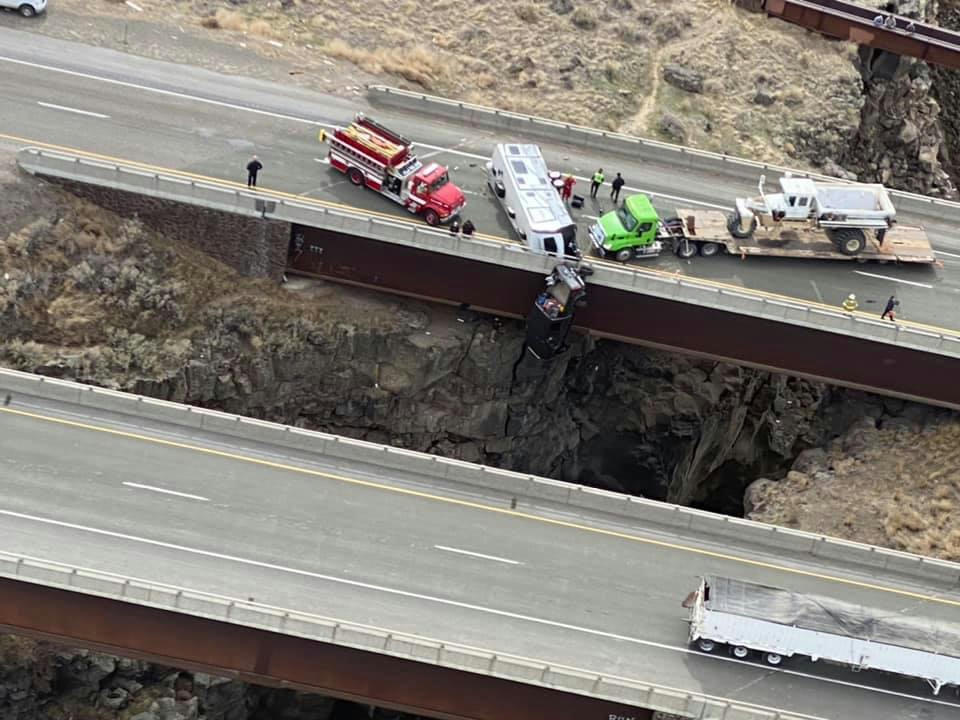 Above a chasm, two people were rescued from a car suspended from a bridge in Idaho