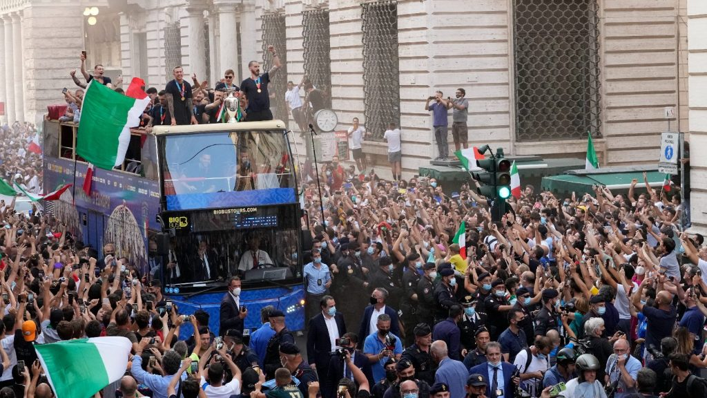 They fenced the bus too!  Hundreds gathered to celebrate the Italian national team