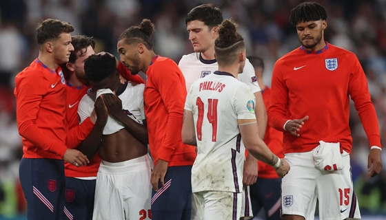 Life + Style: racist attacks English footballers exchange a penalty kick